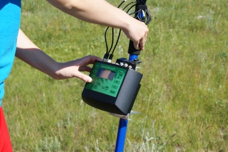 A researcher holding the SpectroSense while taking an NDVI reading.