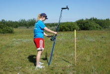 Field researcher Mackenzie reading an NDVI score from the SpectroSense display.